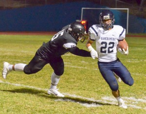 Kamehameha Maui's Covy Cremer (22) gets around a King Kekaulike would-be tackler Saturday. Photo by Rodney S. Yap.