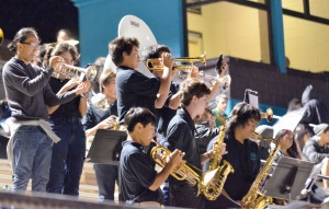 King Kekaulike High School band plays for the home team as the players run out of the locker room to start the second half. Photo by Rodney S. Yap.