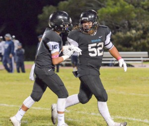 King Kekaulike players Kaena Po'ouahi and Jessie Van Zandt (16) share a moment as the exit the playing field Saturday. Photo by Rodney S. Yap.