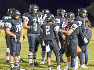King Kekaulike's offense take a break during a second-half timeout Saturday. Photo by Rodney S. Yap.