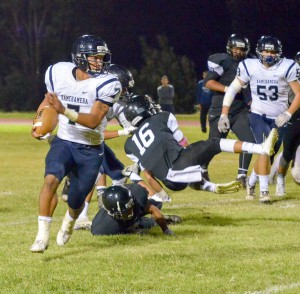 Kamehameha Maui running back Ikaika Chong Kee led all rushers Saturday with 70 yards. Photo by Rodney S. Yap.