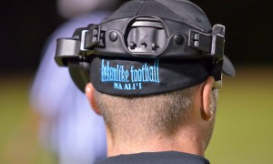 The back of King Kekaulike head coach Kyle Sanches, who happened to take a break from the head phones in the second half Saturday. Photo by Rodney S. Yap.