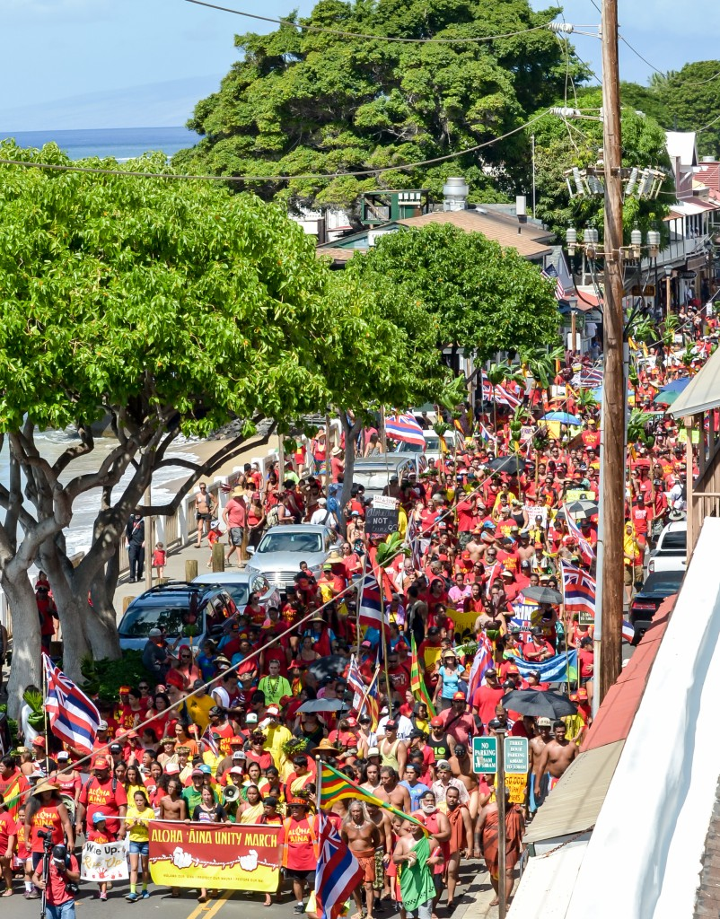 The color red was prominent at Sunday's Aloha ʻĀina Unity March down Front Street in Lahaina, where organizers estimate 6,000 people attended the march and the rally that followed. Photo by Rodney S. Yap.