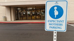 Expectant mothers parking sign at the back entrance to the Women's Macy's department store in Kahului. Photo by Wendy Osher.