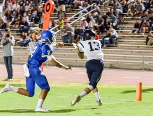 Kamehameha Maui's Maikaike English (13) hauls in this touchdown pass from quarterback Kainoa Sanchez as Maui High's Alani Malafu tries to defend. Photo by Rodney S. Yap.