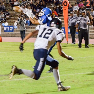 Maui High's Edmund Foronda (83) catches this touchdown pass in front of Kamehameha Maui's Kahai Bustillos. Photo by Rodney S. Yap.