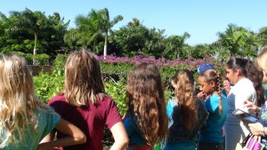 Kamali'i Elementary 5th graders get a tour of the garden they named at Four Seasons Resort Maui. Photo by Kiaora Bohlool.