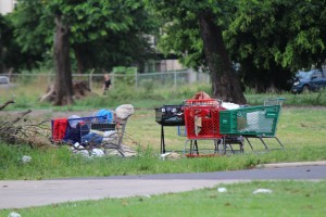 Shopping carts belonging to homeless individuals in the vacant lot next to the Family Life Center in Kahului. Photo by Wendy Osher.