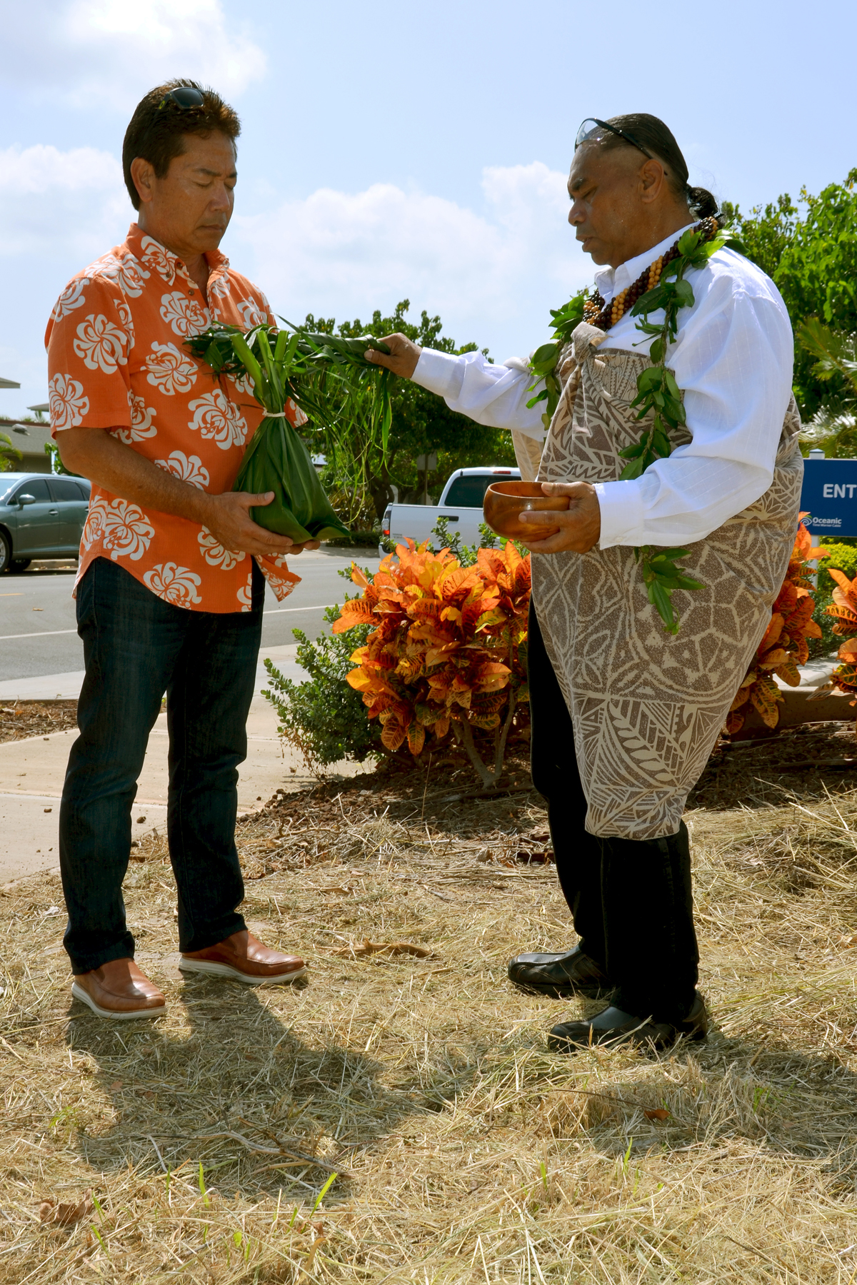 Mark Teruya, chairman and CEO of Armstrong Produce, holds a ho`okupu during the groundbreaking ceremony for construction of Kula Produce's new facility in Maui Lani. Kahu Marcelo Bustillos officiated the private groundbreaking event on October 9. Photo courtesy of Maui Lani Village Center.
