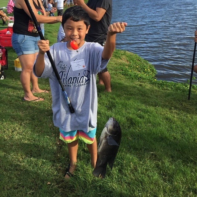 "Isaac Imamura won the ""Tilapa-Whoppa"" award for catching the largest tilapia – 998 grams – during this year's 7th Annual Keiki Tilapia Fishing Tournament 2015 hosted by Maui Electric and Kā'anapali Golf Course."