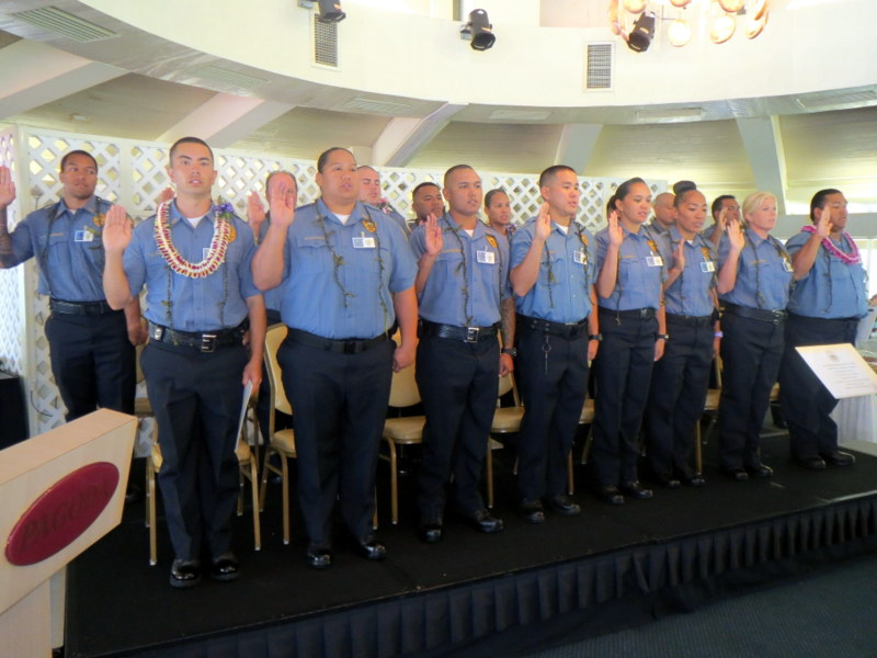 Adult Corrections Officer Recruit Graduation Class taking their oath. Photo credit: Department of Public Safety.