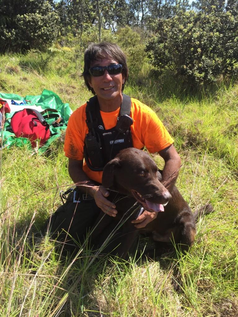 NPS Photo/Park Ranger Arnold Nakata and rescued dog, Romeo. Photo credit: Hawai'i Volcanoes National Park.