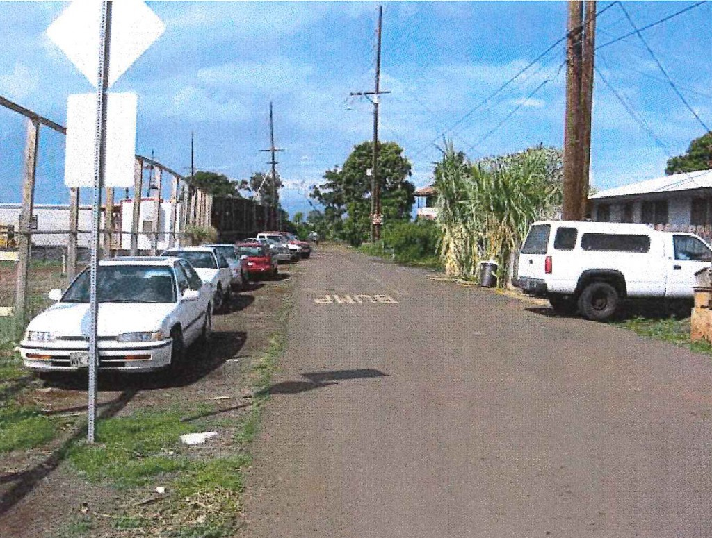 View North on Kuhua Street toward Kahoma Stream Flood Control Channel. Pioneer Mill Site on Left and Old Kuhua Tract Subdivision on right. Photo credit: Munekiyo Hiraga via Final Environmental Assessment prepared for the Maui Department of Public Works.