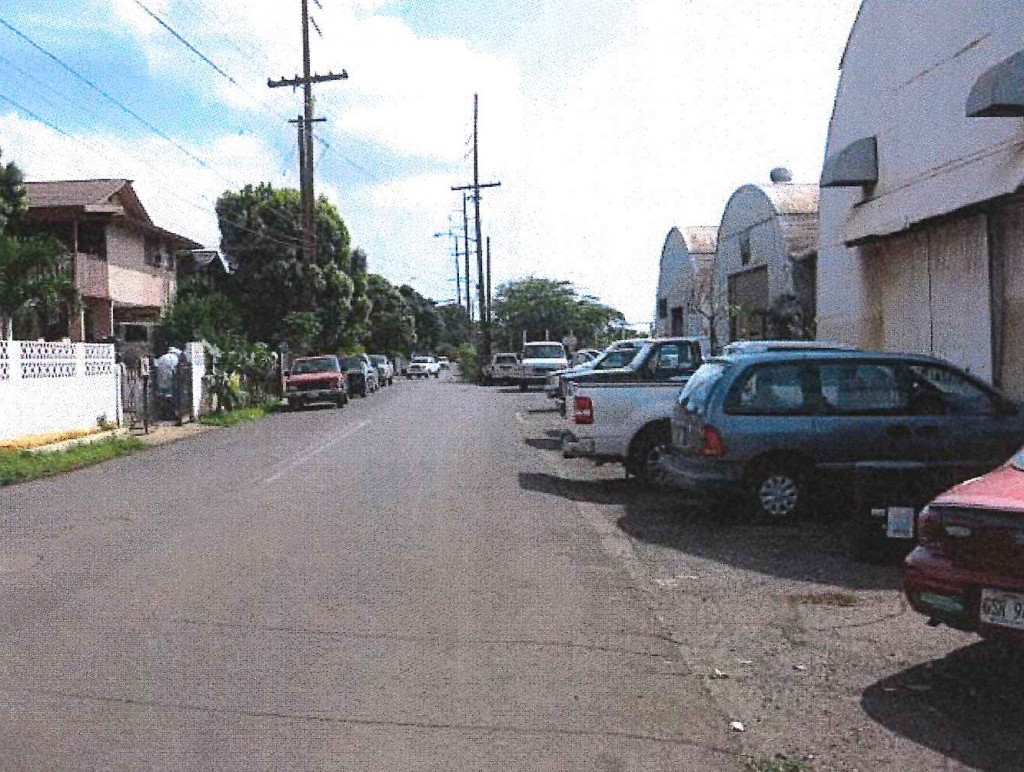 View south near Keone Street on Kuhua Street toward Lahainaluna Road Intersection. Old Kuhua Tract subdivision on left and Pioneer Mill site quonset huts on right. Photo credit: Munekiyo Hiraga via Final Environmental Assessment prepared for the Maui Department of Public Works.