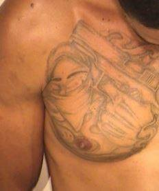 """Shaun M. Dennis has the following tattoos: """"Gangster holding a gun"""" on his right chest and """"96793"""" on his right forearm."""