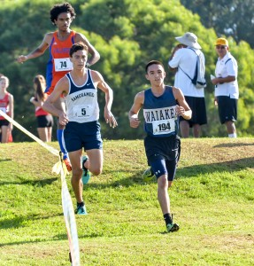 Runner-up boys finisher Louie Ondo of Waiakea runs ahead of Kamehameha's Kaeo Kruse at the beginning of the race Saturday at Seabury Hall. Photo by Rodney S. Yap.
