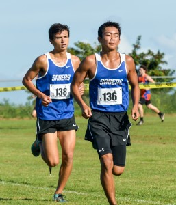 Maui High's Deion Giron (136) and Shaye Thorup helped the Sabers finish seventh in the team standings Saturday at Seabury Hall. Photo by Rodney S. Yap.