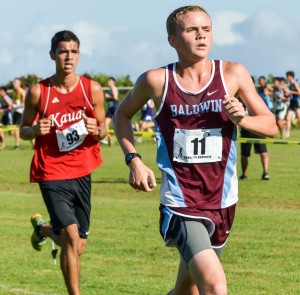 Baldwin and Kauai runners try to keep pace with the leaders through the first lap of the boys race Saturday at Seabury Hall. Photo by Rodney S. Yap.