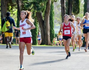 Seabury Hall's Ava Shipman leads Iolani's Amanda Beaman early in the first mile Saturday at Seabury Hall. Photo by Rodney S. Yap.