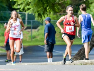 Iolani's Amanda Beamon takes over the lead from Seabury Hall's Ava Shipman during the second loop of the three-mile race at Seabury Hall. Photo by Rodney S. Yap.