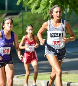 Kihei Charter's Maya Reynolds climbs a hill through the first mile Saturday at Seabury Hall. Photo by Rodney S. Yap.