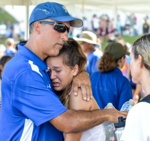Seabury Hall head coach Bobby Grossman gives Ava Shipman a big hug following her fourth-place finish Saturday at the state cross country championships. Photo by Rodney S. Yap.