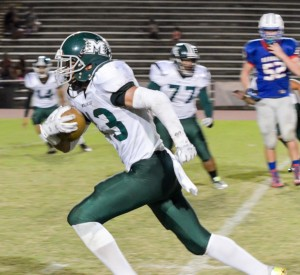 Molokai's Kaiea Dowling returns this interception 35 yards for a touchdown in the third quarter Saturday. Photo by Rodney S. Yap.