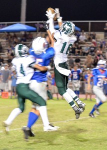 Molokai's William Dela Cruz (16) breaks up this pass intended for a Seabury receiver. Photo by Rodney S. Yap.