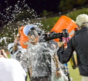 The Molokai players get head coach Mike Kahale with a Gatorade bath on the sidelines Saturday. Photo by Rodney S. Yap.