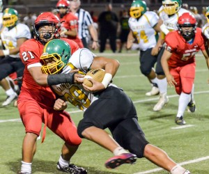 Lahainaluna's Donovan Defang tackles Kaimuki's Billie Masima one-on-one during second-half action Saturday. Photo by Rodney S. Yap.