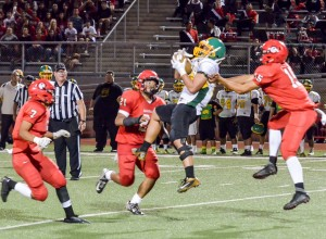 Lahainaluna's secondary converges on Kaimuki's receiver after he catches a pass in the middle of the field. Photo by Rodney S. Yap.