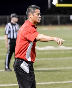 Lahainaluna co-coach Garret Tihada gives the offense final instruction before lining up for the last snap of the game. Photo by Rodney S. Yap.