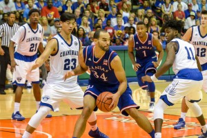 Kansas' Perry Ellis works the low-post against Chaminade's Kevin Hu (23) and David Ware (11). Ellis scored 11 points Monday. Photo by Rodney S. Yap.