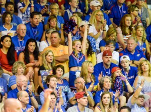 One extra excited Kansas fan jumps off her seat screaming her support for the Jayhawks. Kansas fans had plenty to ceer about Mondat as the Jayhawks defeated host Chaminade, 123-72. Photo by Rodney S. Yap.