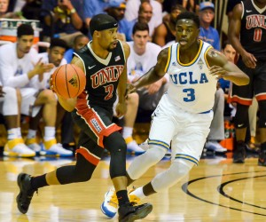 UNLV's Jerome Seagears completes a bounce pass as he hurries to bring the ball up-court against UCLA defender Aaron Holiday. Photo by Rodney S. Yap.