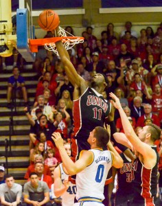 UNLV's Goodluck Okonoboh (11) is called for goal tending on this play as his swats the ball from inside the rim. Photo by Rodney S. Yap.