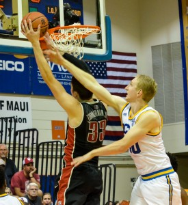 UCLA's Thomas Welsh blocks a would-be basket by UNLV's Stephen Zimmerman during second-half action Monday at Lahaina Civic Center. Photo by Rodney S. Yap.