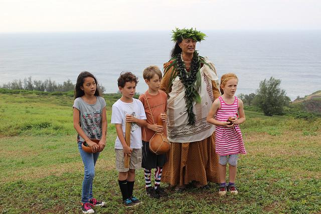 Island School children and Kumu Sabra Kauka Sing 'Oli. Photo credit: Ann Bell/USFWS