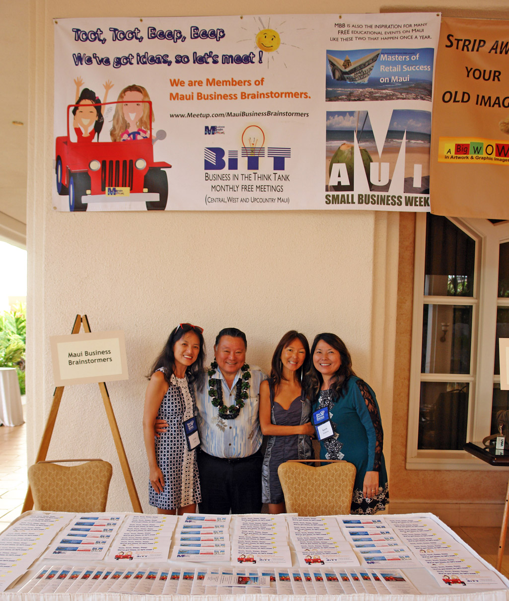 (Left to right) MBBer Grace Fung, Maui Mayor Alan Arakawa, Maui County Business Resource Center Manager Karen Arakawa and MBBer Juliet Gray at the MBB table during the 2015 Hui Holomua 9th Business Fest. MBB photo.