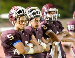 From left, Baldwin's Kawena Alo-Kaonohi, Aloalii Laga, and Chayce Akaka pose for a photo during a break late in their game with Maui High last week. Photo by Rodney S. Yap.