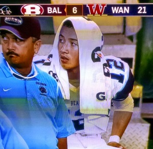 Bladwin quarterback Chayce Akaka takes a break on the sidelines late in the game Friday against Waianae. Photo from OC16 broadcast.