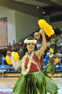 A Maui hula dancer performs during a break in the action Tuesday at the Maui Invitational Tournament. Photo by Joel B. Tamayo.