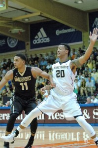 Wake Forest's John Collins works the low post against Vanderbilt's Jeff Roberson Tuesday at the Lahaina Civic Center. Photo By Joel B. Tamayo.