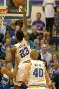 UCLA's Tony Parker goes up for a basket Tuesday against Kansas. Teammate Thomas Welsh (40) looks on. Photo by Joel B. Tamayo.
