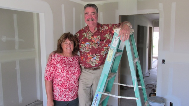 Sandra Duvauchelle (left) is the general contractor who is building the prototype Na Hale O Maui affordable home on Kama Street in Waikapu. With her is John Andersen, executive director of the NHOM Community Land Trust, Andersen has placed 30 families in homes that will remain affordable in perpetuity and never go to market price. Courtesy photo.