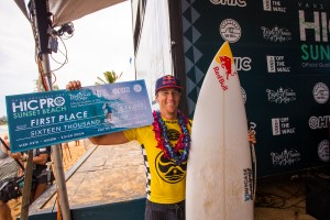 Ian Walsh from Maui smiles on the podium, taking first place at the HIC Pro ten years after his first win at the same event. Photo courtesy of World Surf League (WSL).