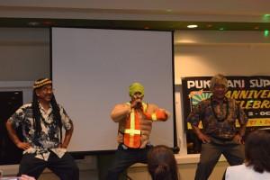 Pukalani Superette 60th Anniversary celebration. Owners dancing with Emcee Kaleo Pilanca.
