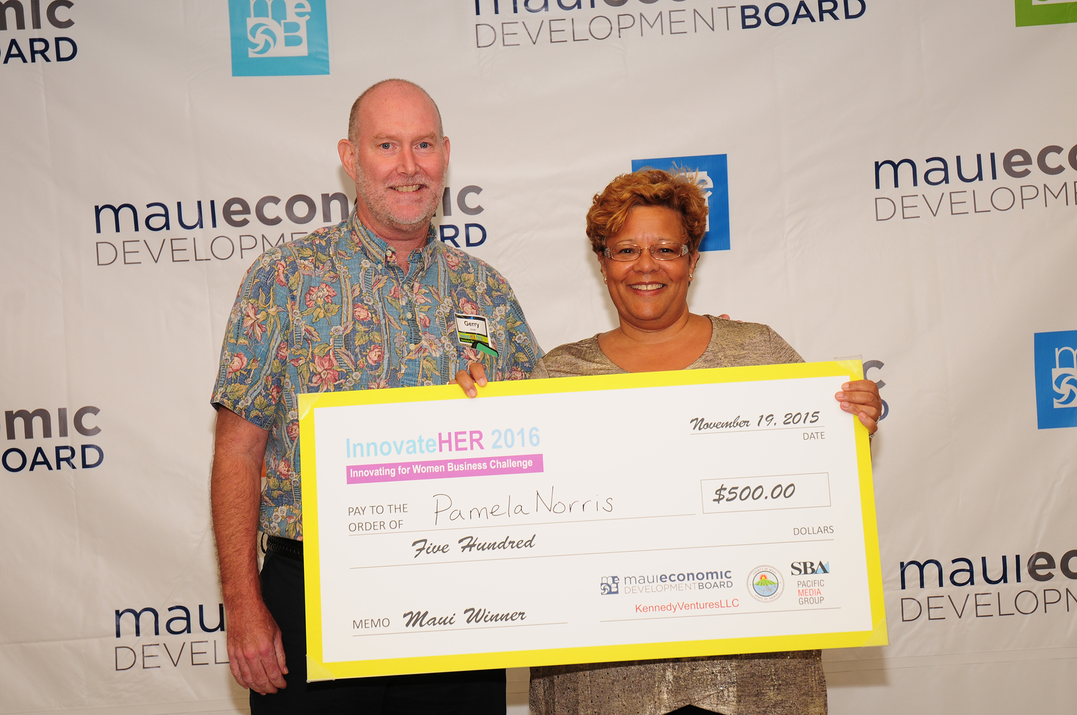 MEDB's Gerry Smith with first winner Pamela Norris. She received $500 in cash as the Maui winner. If selected by the SBA as a national finalist she'll have an opportunity to compete for $70,000 in prize money.