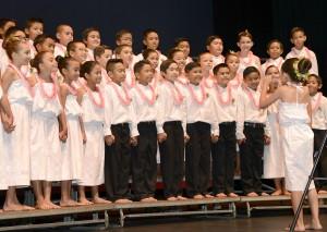 Pōmaikaiʻi Elementary School, grades 4-5 perform with sign language.