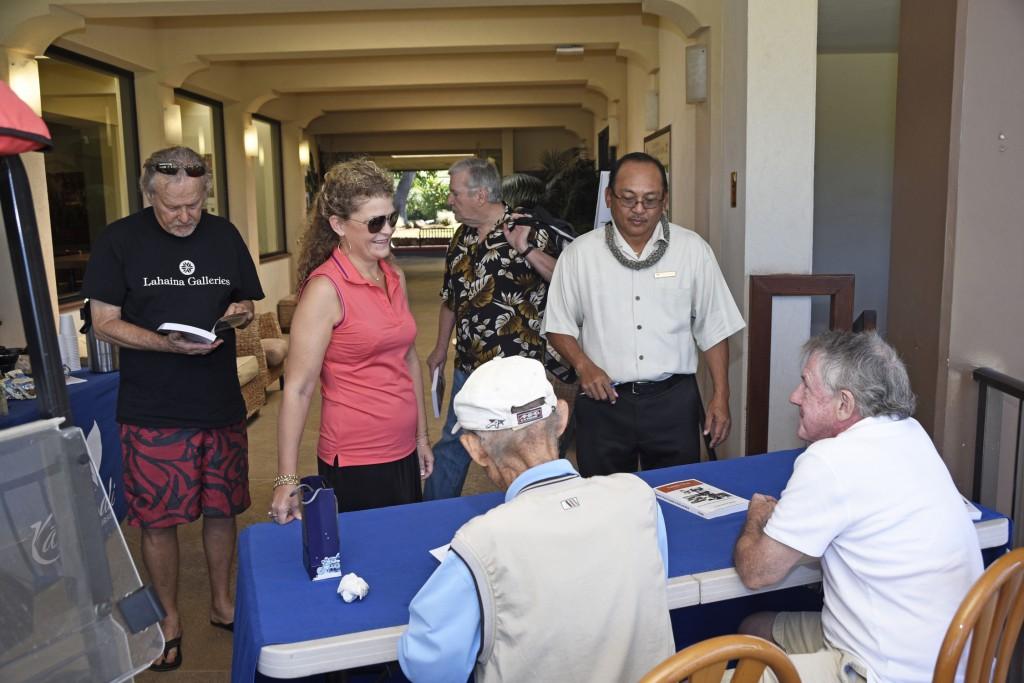 Tommy Sarashina signing copies of the book. Image courtesy: Kāʻanapali Golf Courses.